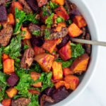 Sweet Potato Beet Kale Salad in white serving bowl with spoon
